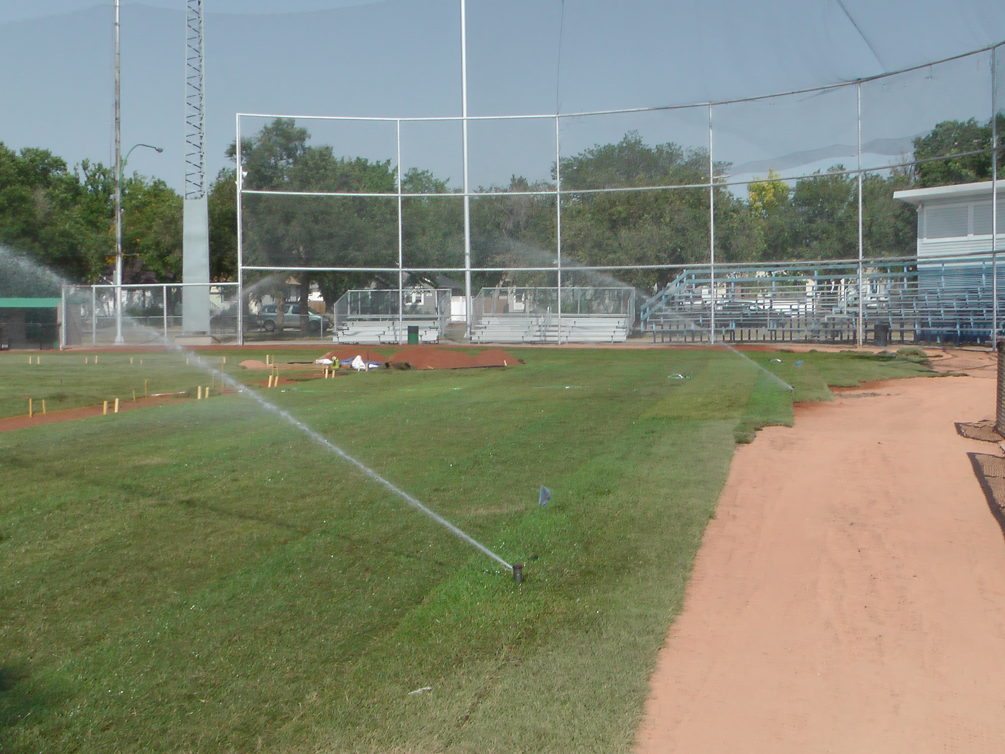 Sept 7 & 8 2018, Optimist Park Field Renovations, sod down being watered - Image 2