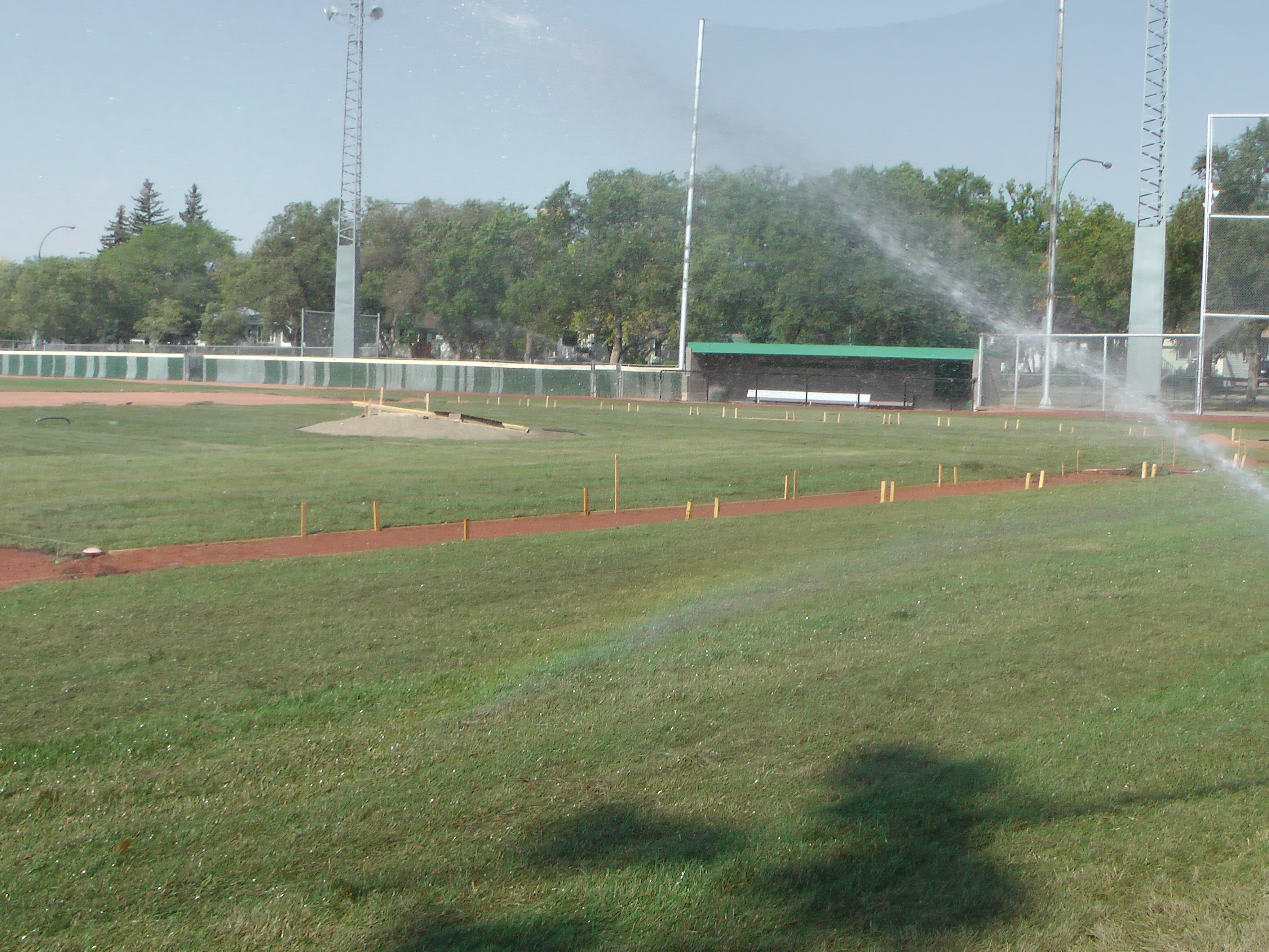 Sept 7 & 8 2018, Optimist Park Field Renovations, sod down being watered - Image 4