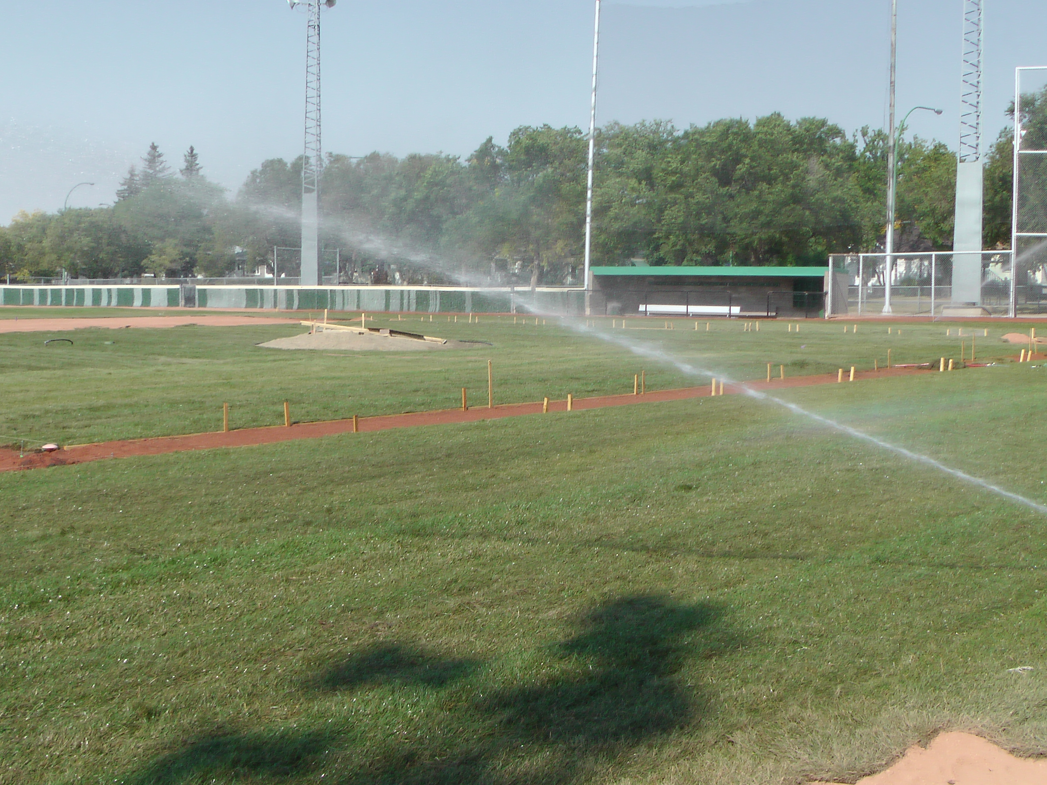 Sept 7 & 8 2018, Optimist Park Field Renovations, sod down being watered - Image 6